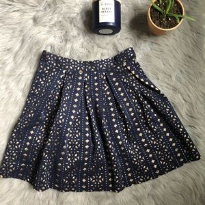 Blue Rain pleated skirt with gold laser cut out